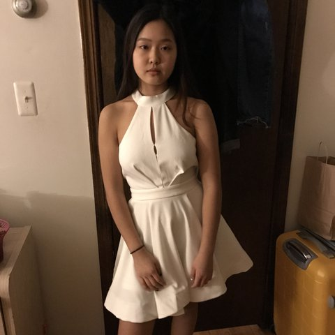 5d1f9ee20a5 Lulu s Backless White Halter dress. It is stitched in the - Depop