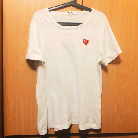 a03690b636c4e3 @angus666. 3 years ago. Manchester, Manchester, UK. Comme des Garcons PLAY  White tshirt.