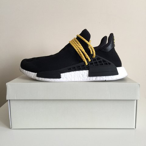 5df9b92d49780 Adidas Human Race Pharrell Williams NMD Black   Yellow - UK - Depop
