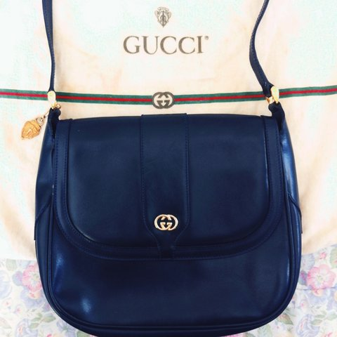 f064e6aa3ce  thunderbirdthreads. 3 years ago. Authentic GUCCI navy blue leather 1980 s  crossbody flap bag with detachable gold ...