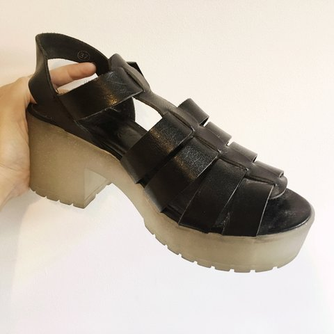 e40489d89091 @rhack__. 3 years ago. London, United Kingdom. Urban Outfitters Out From  Under black leather strappy sandals with a glittery jelly ...