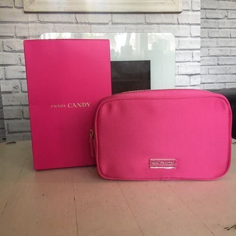 63112e95c58f @amyings1. 6 months ago. Grantham, United Kingdom. Prada candy pink makeup  bag brand new ...