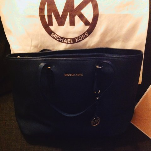 0b1731648 Michael Kors jet set travel for sale. Barely worn, navy with - Depop