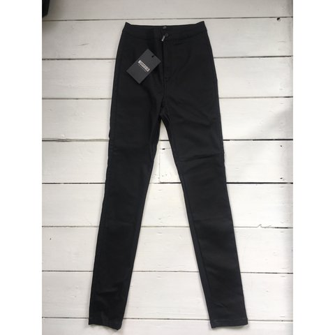 8c77fac1 Coated black high waisted skinny jeans. Never worn before, - Depop
