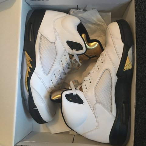 9f5b95569ccd3a Nike Air Jordan Retro 5 white metallic gold size U.K. 11 pm - Depop