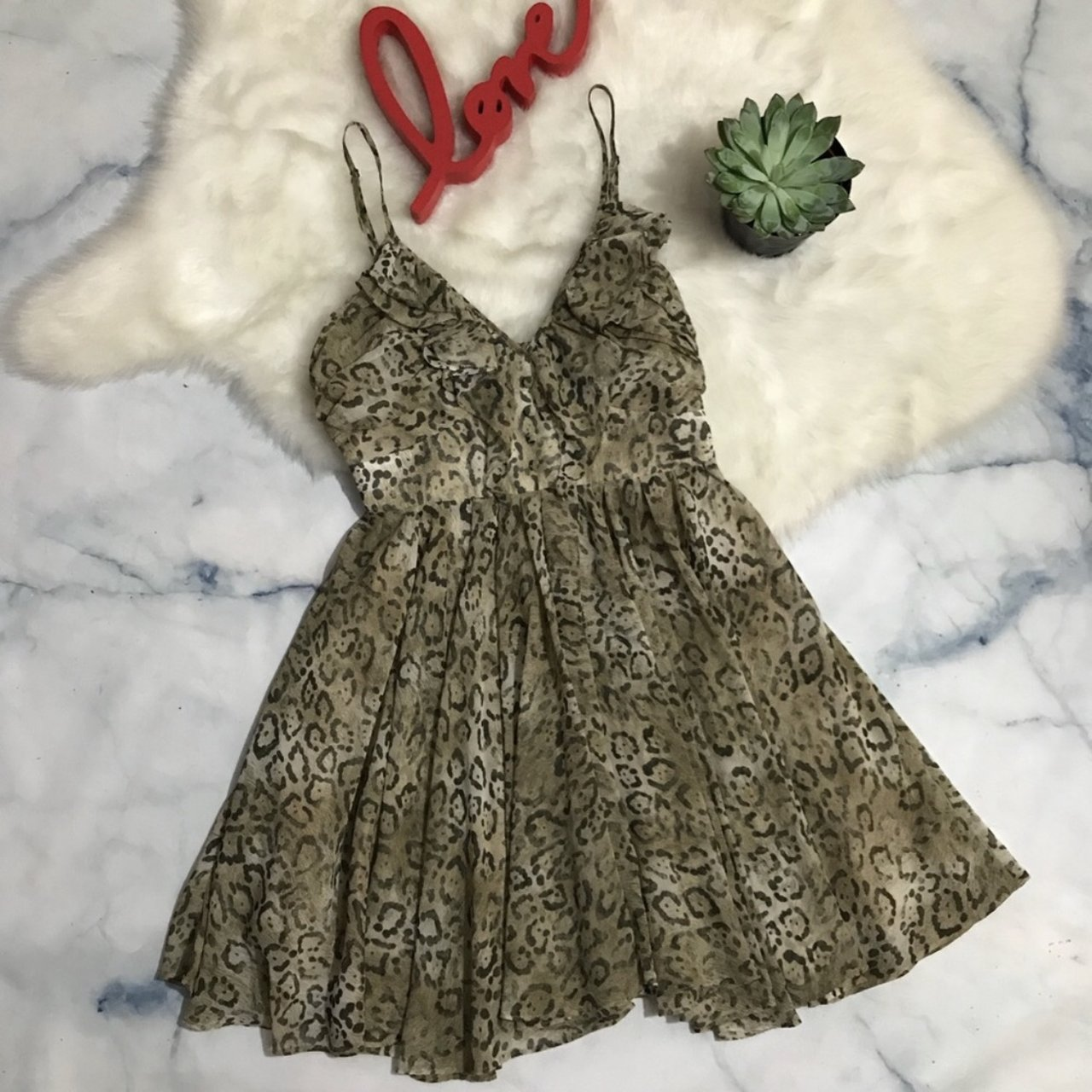 0ef4e2fdd1 FREE DRESS Pictured Leopard Print Skater Dress from Guess. a - Depop
