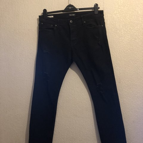 0987bded @topboyfashion. 9 months ago. London, United Kingdom. Jack and Jones ripped  jeans. Slim Fit Size : waist 34 length 30