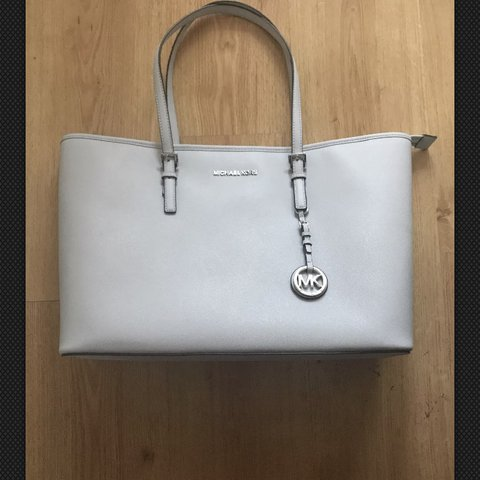 aea591c66a0a @magicorn. last year. United Kingdom. Authentic Michael Kors jet set tote  with laptop ...
