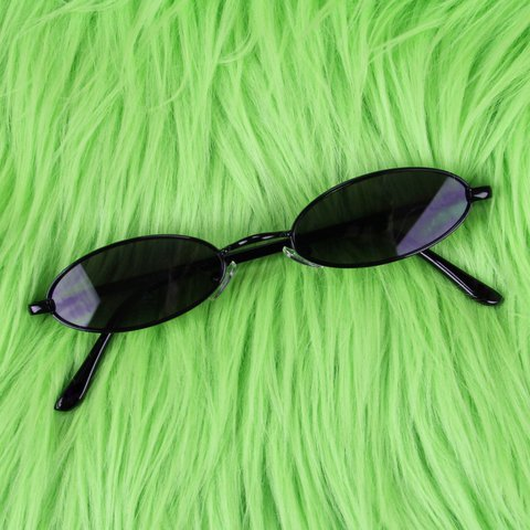 488934c678f Slim Oval Sunglasses featuring black metal frames and black - Depop
