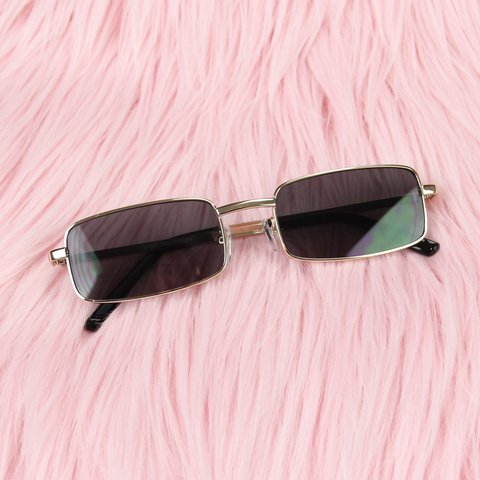 1ff34bb4b2d Rectangular Sunglasses featuring gold metal frames and black - Depop