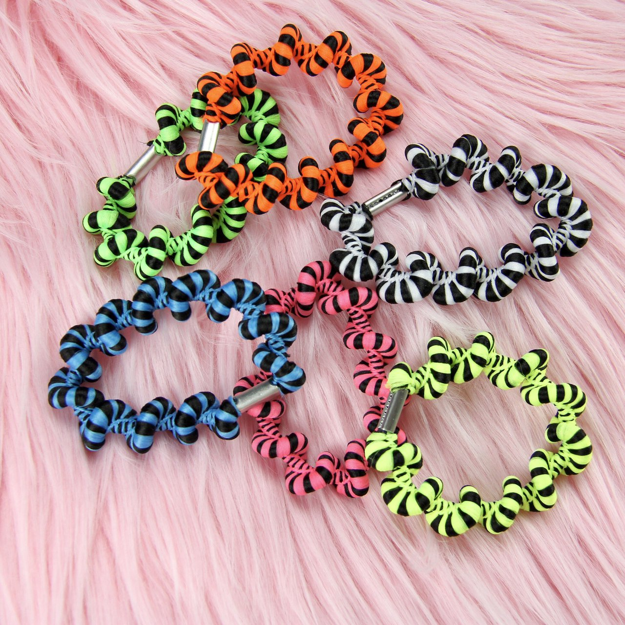 Trippy swirly hair ties in the coolest colors. Perfect for a - Depop 7bb955391b9