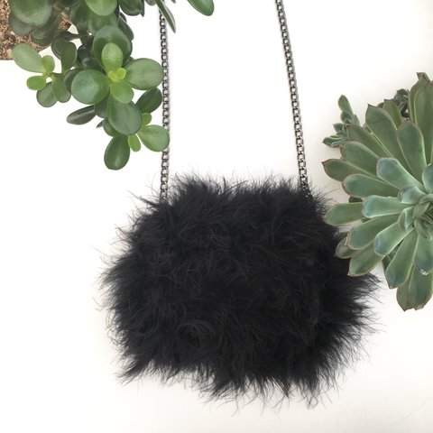 24354f0db @sophiclempso0. 7 months ago. Stevenage, United Kingdom. Topshop fluffy  cross-body bag 💗 Made with black faux feathers
