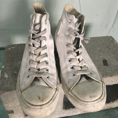 45b84075deccec White leather high top Converse all stars. Worn and dirty it - Depop