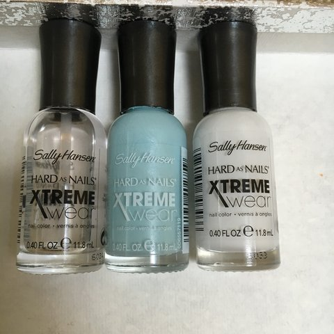 3 Sally Hansen hard as nails - nail polishes one in the on\