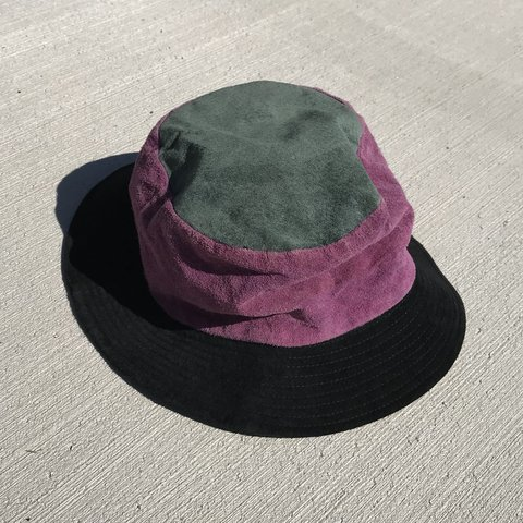 ee6d116a the holy grail of all bucket hats. this is a purple, black, - Depop