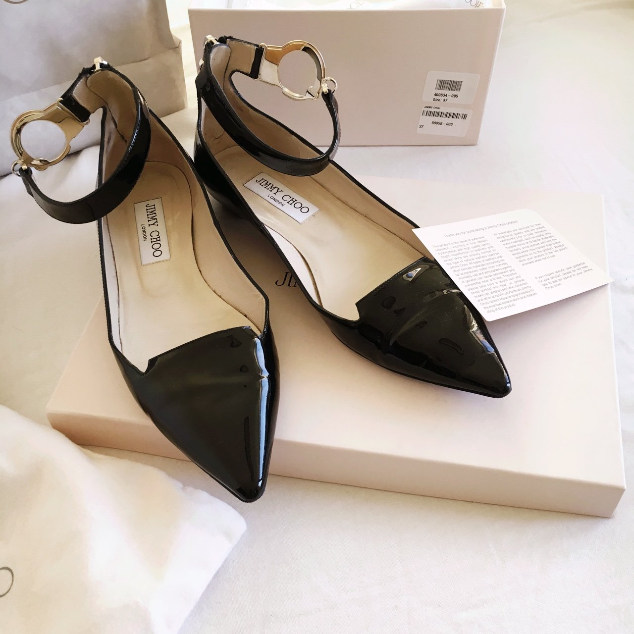 6de5a1f2857 Black Patent  jimmychoo flat shoes. Size  37 zip at the back - Depop