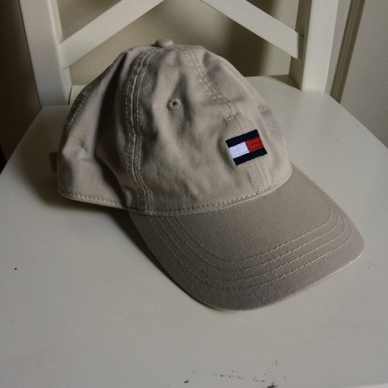 4ce7491085b Tan Tommy Hilfiger hat it s in perfect condition and has one - Depop