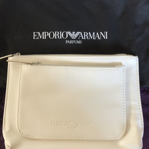 87377f7a84c7 EMPORIO ARMANI white cosmetic pouch   case with front pocket - Depop