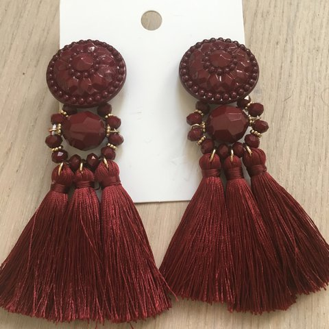7287d04ad @minnielambs. 2 years ago. Salford, United Kingdom. H&M Dark Red Tassel  Earrings