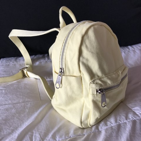 e0185c6f800952 LA Hearts from Pacsun mini yellow canvas backpack. Brand - Depop