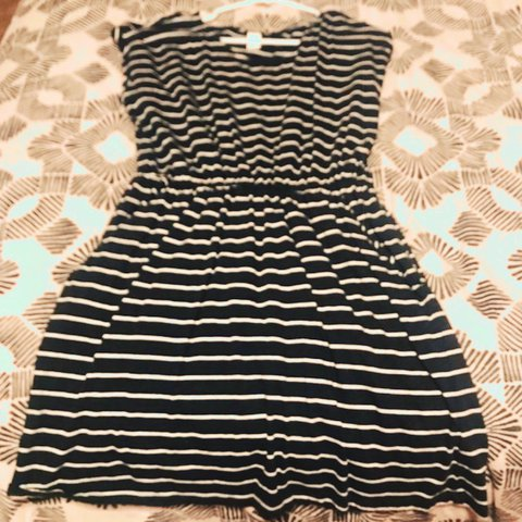 e1bf3c45a10b @lmcg304. last year. Overland Park, United States. Short sleeved black and  white striped dress with pockets from H&M. Elastic waist.