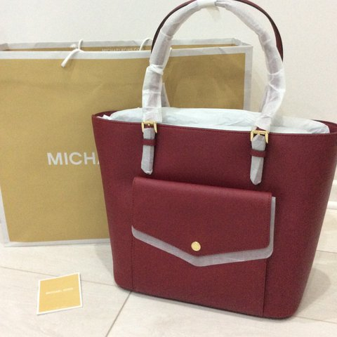 703bd5391a3e @desalidesigners. 2 years ago. Swindon, UK. Michael Kors genuine, Jet set,  berry colour medium tote bag. BRAND NEW with tags ...