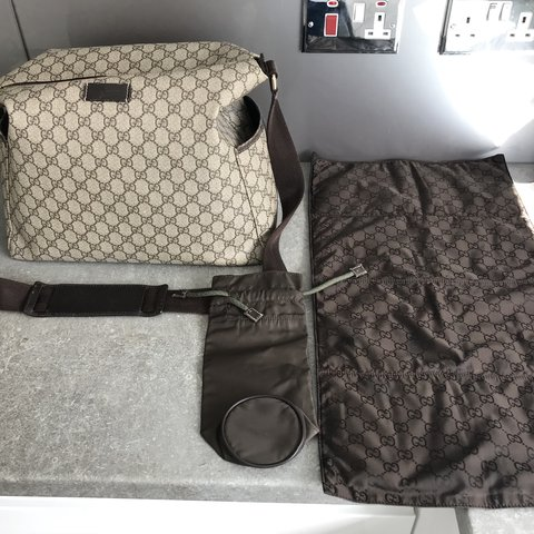 084a5bb85d256b @kimmygx. 5 months ago. Glasgow, United Kingdom. Gucci baby changing pram  back leather style gg with top zip ...