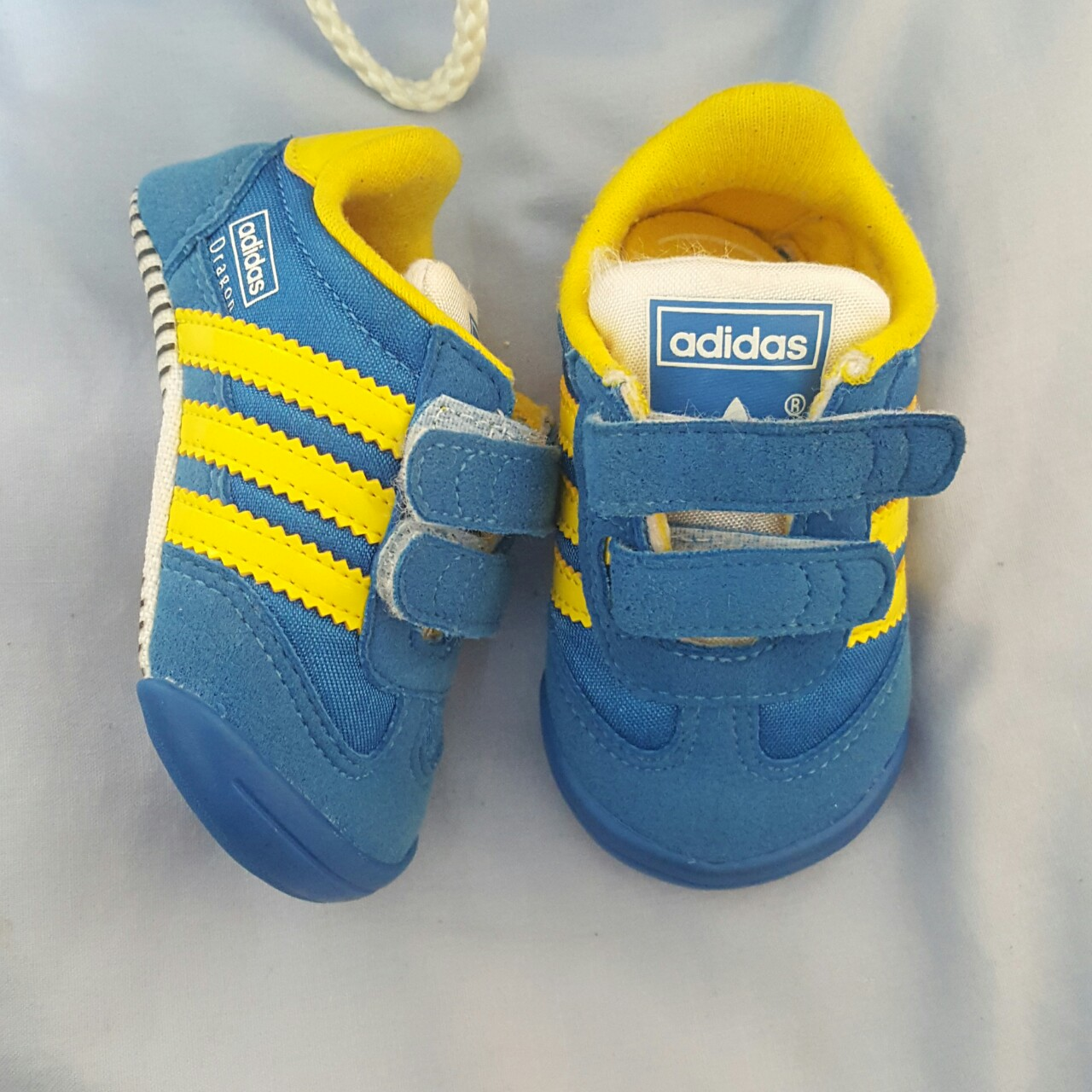Infant size 2 Adidas dragon in blue white & yellow...