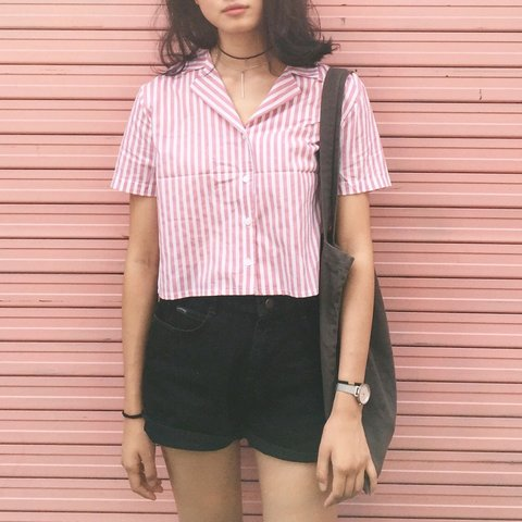 87c08891 @xinditian. last year. New York, United States. Pink striped cropped button  down.