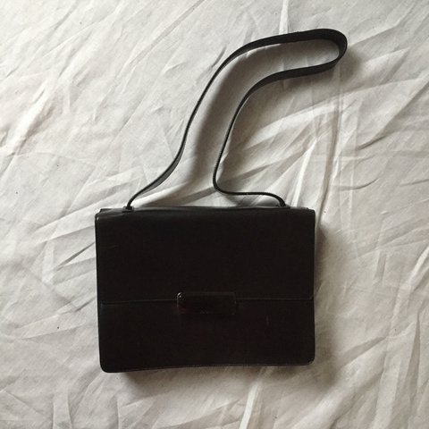 337ee9aa0e23 Late 90s or early 2000s black leather Prada bag with brown x - Depop