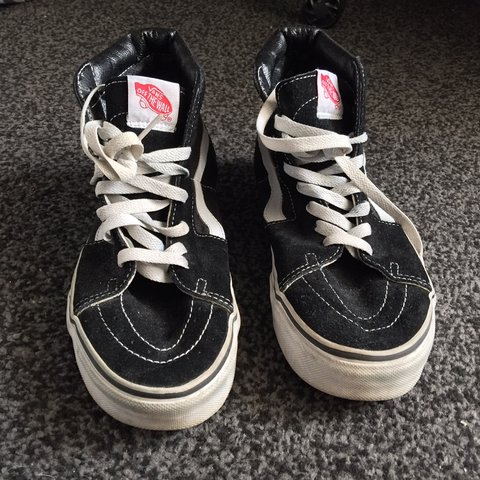 6022344e94 Black and white hi-top vans