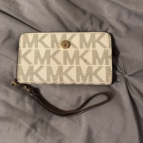 158b06752e912b @yatzeldel. 19 days ago. Fort Worth, United States. Michael Kors Wristlet  And phone carrying case. Will fit any iPhone ...
