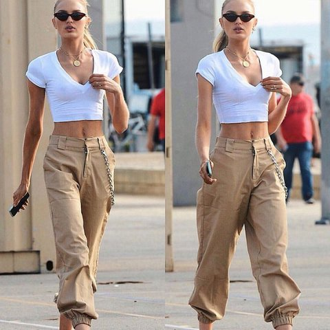 Image result for beige pants with a chain