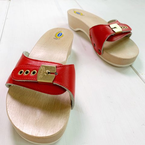 40ecd5c3f7bb  propsandpieces. 7 days ago. United States. Candy apple red vintage Dr.  Scholl s slip-on 🍎 The original exercise sandal ...