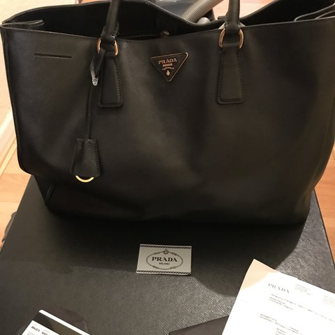 fce60e46910f5c @san_bella. last year. London, United Kingdom. Prada saffiano. Black leather.  Authentic Box and authenticity card included