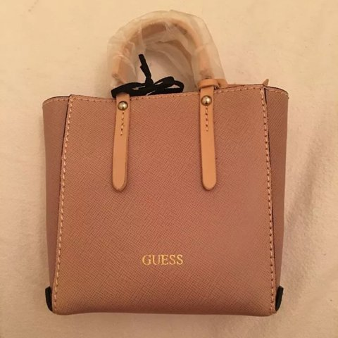 Mini guess pink bag. Very Kylie Jenner! Can just about fit - Depop 8d9d92ebb9445