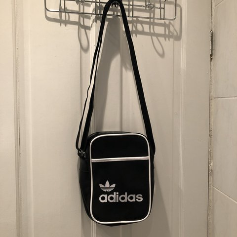 38756e7e36 @rhii14. 6 months ago. Dudley, United Kingdom. Adidas originals black side  bag. 10/10 condition hardly used.