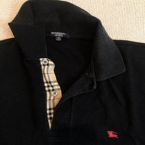 e0389545b Burberry polo 9 10 condition Label says XL but fits more a - Depop