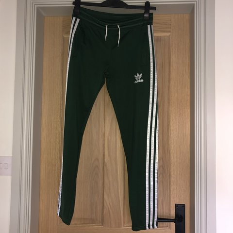 1a220d1b2e5c2 Adidas green joggers. Three white stripes down either side. - Depop