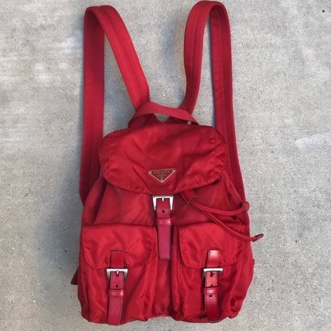 4dd0f9543ddb @lindajia. 3 months ago. New York, United States. PLEASE MESSAGE BEFORE  BUYING Authentic Rare red mini Prada vela backpack