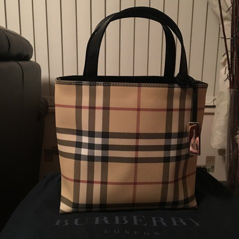 8cb2cd9fa4fb NEW LOWER PRICE    Authentic Burberry Leather Bag. Price - Depop