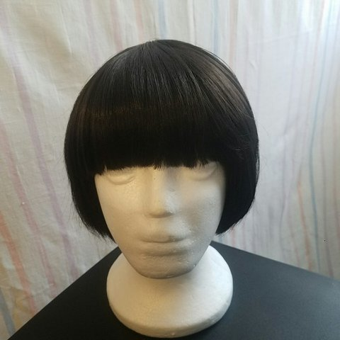 Black Bobbi Boss Bob Wig With Blunt Cut Bangs Worn For A Depop