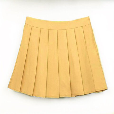 d1e052df6aed @emanning. last year. United Kingdom. Mustard yellow pleated tennis skirt 🍬