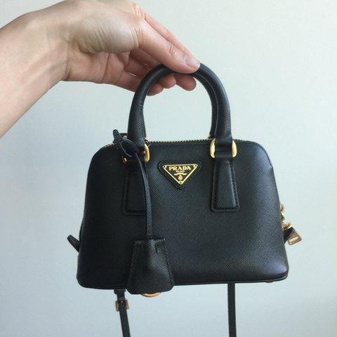 e6dfbf54e3a3 @winnie7972. 10 months ago. Los Angeles, United States. Authentic Prada  Saffiano Mini Cross Body ...