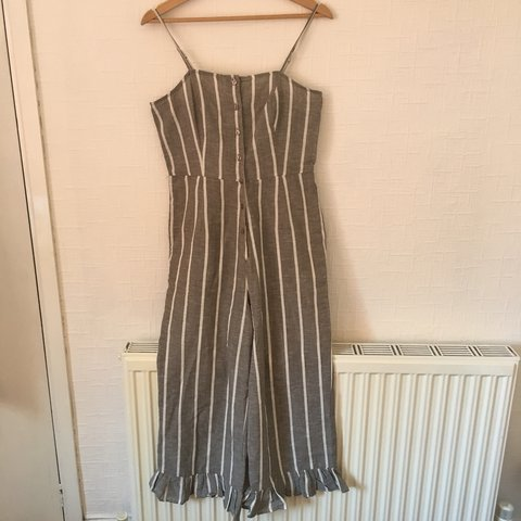 a1a438abc644 Grey and white striped jumpsuit with frill detail. I got but - Depop
