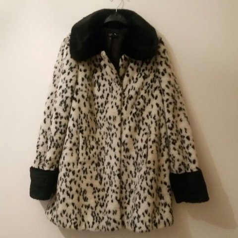 d7340496e459 @sailorellie. 3 years ago. Brechin, United Kingdom. Super snug size 10  Topshop faux fur coat. Leopard print with black collar ...