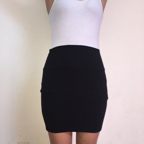 8f915b005 Tight black pencil skirt. Really stretchy material makes for - Depop