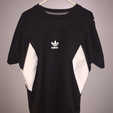 e389aca9 @jackhoban. 8 days ago. United Kingdom. Vintage black and white Adidas T- shirt