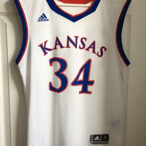 f490d3046d60 KU basketball jersey in size small. Worn and washed three - Depop