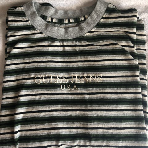426cc1303d @vanoah_. 10 months ago. Richmond, United States. Guess Authentic Grey/Dark  Green striped tee shirt. Size Large Condition 9/10